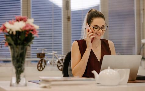 Female entrepreneur working in her desk