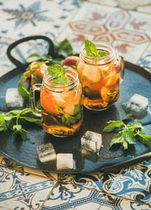 Summer refreshing cold peach ice tea with fresh mint