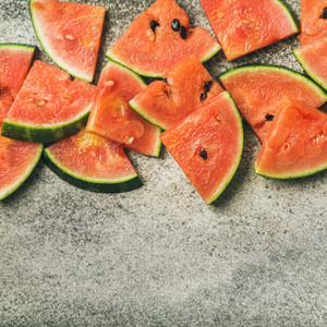 Juicy watermelon pieces over concrete stone background square crop
