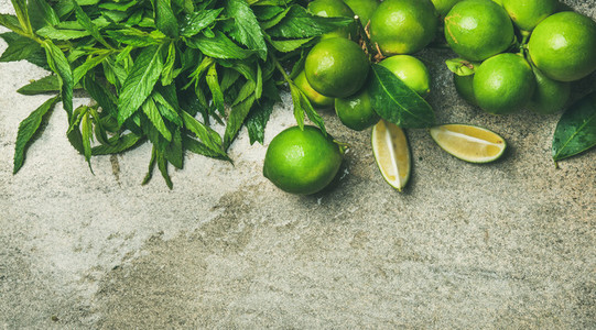 Flatlay of fresh limes and mint for making cocktail