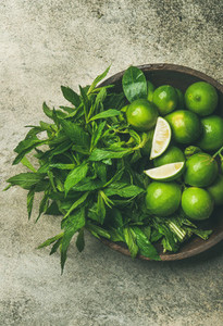Flatlay of fresh limes and mint  top view