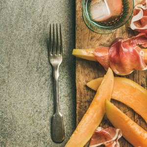 Summer wine party set with rose wine prosciutto on board