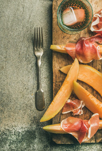 Summer wine party set with rose wine prosciutto fresh melon