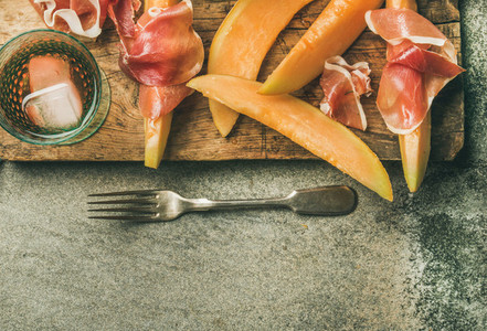 Summer wine party set with rose wine  prosciutto ham  melon