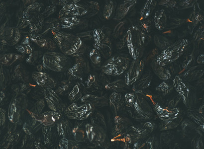 Flat lay of black dried raisins top view