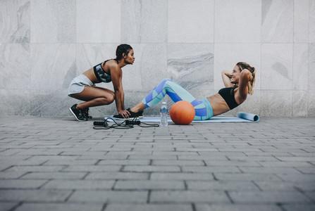 Women doing workout outdoors on a street