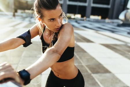 Woman in fitness wear training outdoors