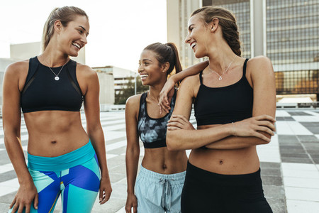 Smiling fitness women out on street for morning jog