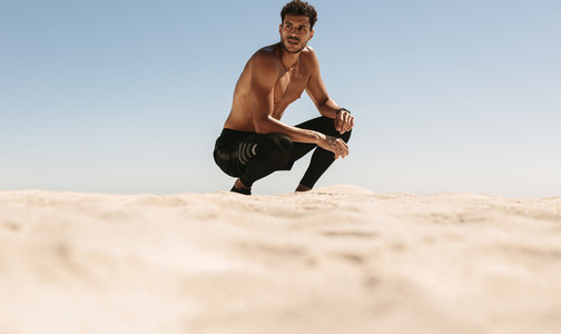 Man relaxing after workout on the beach
