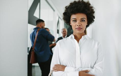 Confident woman in office corridor
