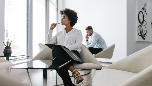 Woman working in modern office lobby