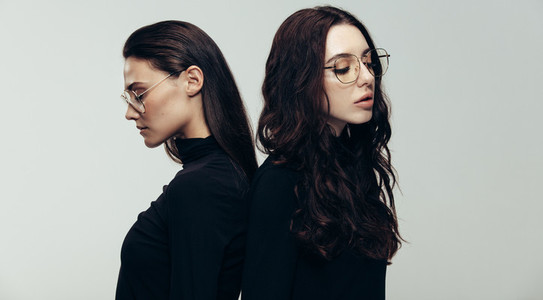 Female models in black outfit and glasses