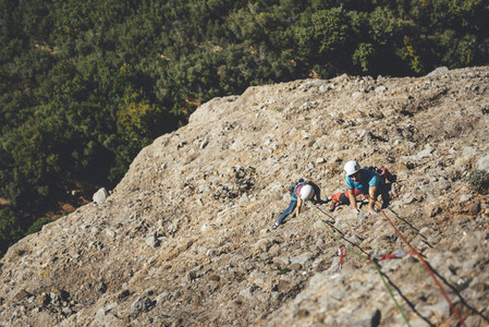 Young couple of climbers sharing a rockclimbing route in Los Mallos de Riglos Spain
