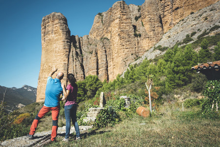 Couple of climbers looking to a climbing route in Los Mallos de Riglos  Spain