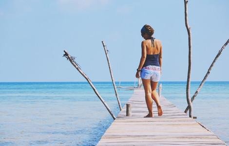 Hot girl in jeans on pier