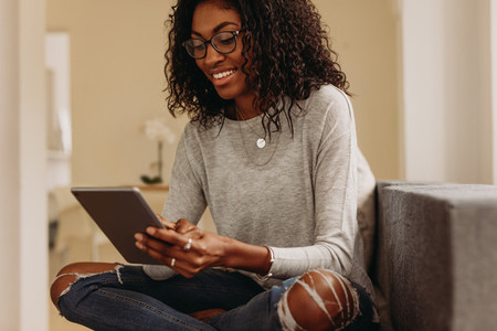 Woman using tablet pc sitting at home