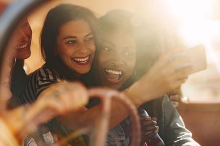 Friends taking selfie in the car