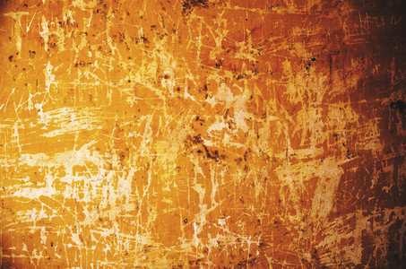 Old scratched yellow wall