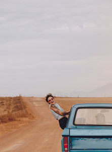 Woman looking excited on road trip