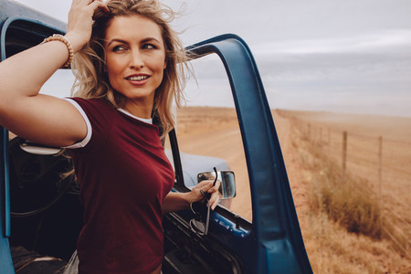 Woman on road trip in countryside