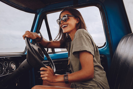 Woman on road trip having fun driving a car