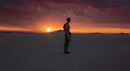 Athlete looking at desert sunset