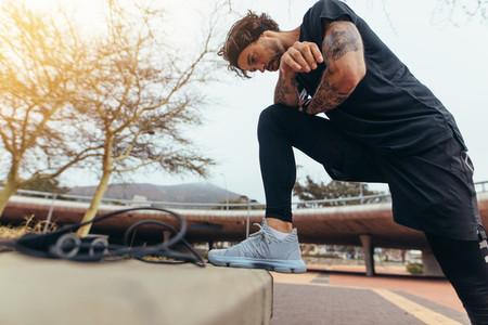 Sportsman taking a break from outdoor training