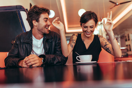 Couple enjoying their time over a coffee at a diner