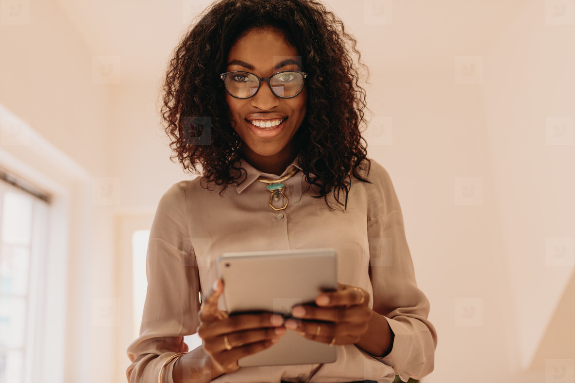 Businesswoman standing holding a tablet pc