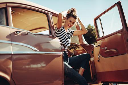 Beautiful woman driving old car