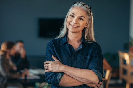 Smiling woman in casuals in off
