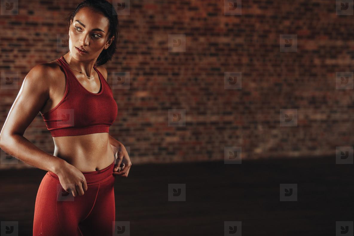 Sportswoman during workout break in gym