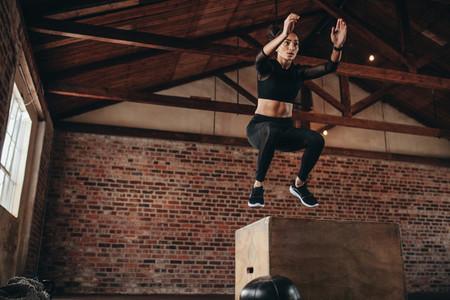 Box jumping workout at gym