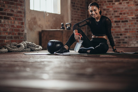 Female resting after exercise at fitness studio