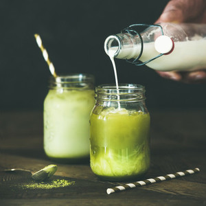Cold refreshing summer iced coconut matcha latte drink  square crop