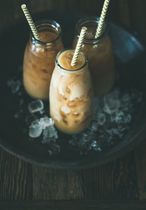 Cold Thai iced tea in bottles with milk  copy space