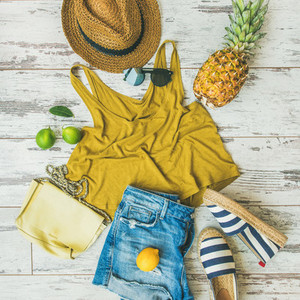 Colorful summer fashion outfit flat lay over pastel background  square crop