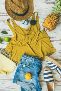 Colorful summer fashion outfit flat lay over pastel parquet background