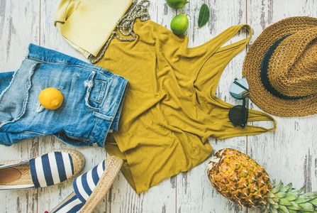Colorful summer fashion outfit flat lay over pastel background  top view