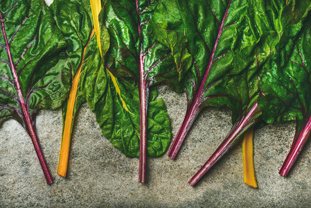 Flat lay of fresh green leaves of swiss chard  top view