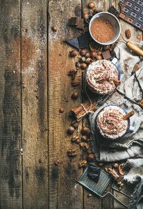 Hot chocolate with whipped cream  nuts  spices and cocoa powder