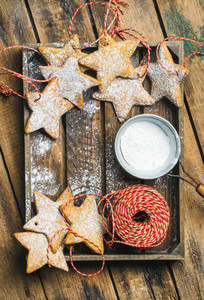 Christmas star shaped cookies with sugar powder and decoration rope
