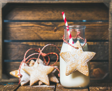 Christmas festive gingerbread star shaped cookies and bottle with milk
