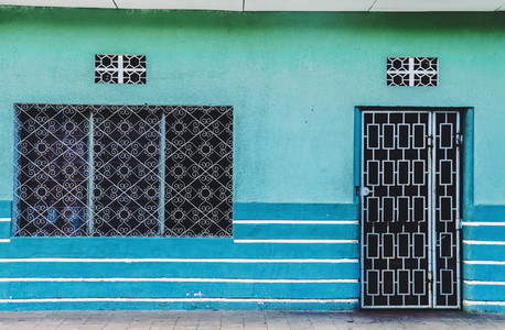 Vibrant blue old house facade