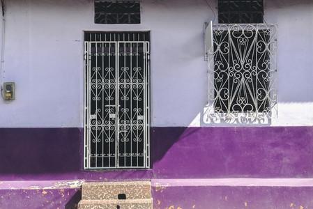 Old vibrant purple house facade
