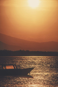 Boat at sea during sunset
