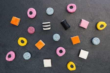 Liquorice allsorts candy sweets dark background