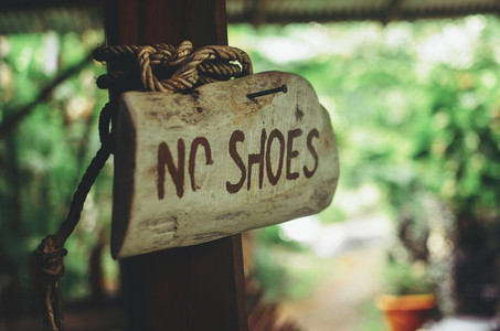 No Shoes wooden sign