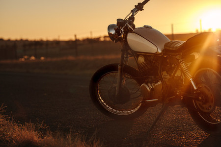 Classic motorbike standing on the road