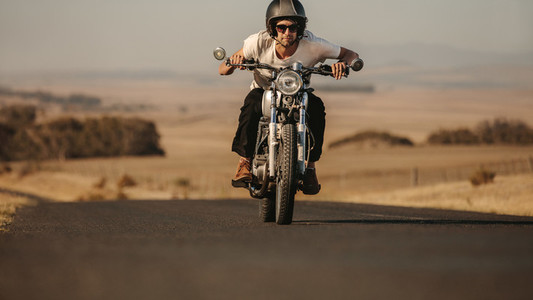 Man riding on a fast motorcycle
